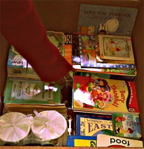 Photo of a box of books and school supplies for The Book Bridge Library in Puerto Princesa, Palawan, Philippines