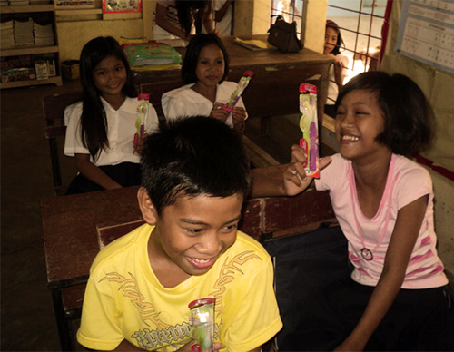 BES Pupils with their new toothbrush