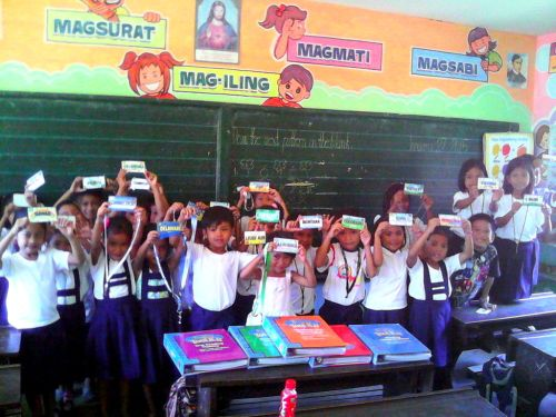Books and US state cards given to VInisitahan Elementary School pupils